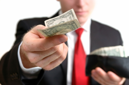 Businessman_Handing_a_Dollar_4372659Medium
